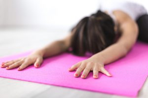 Canva - Woman Exercising on Yoga Mat